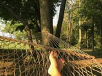 Look up under the trees while lying on the hammock. Be careful, a nap will ensue.