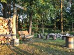 Private wooded setting with a swing, hammock, and fire pit.