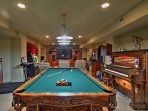 Spend at-home evenings in this expansive game room.