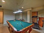 Practice your trick shots on this 8-foot carved pool table.