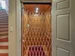 Access all 3 levels of the home using this in-house elevator.