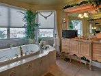 Enjoy a soothing soak in this large garden tub.
