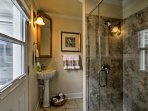 Rinse off in this pristine walk-in shower.