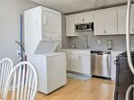 Stainless steel appliances and marble countertops highlight the fully equipped kitchen.