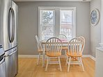 Serve homemade meals at the quaint 4-person dining table.