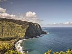Admire the towering cliffs, waterfalls, and black sand beaches of Waipi`o Valley.
