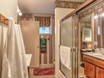 Wash up in the full private bathroom, boasting a bright vanity and shower/tub combo.