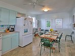 This bright kitchen comes fully equipped and the dining table set for 6.