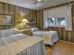 Each bedroom features a queen-sized bed and twin bed.