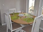 Dining table set for 4, and will seat 6 if needed