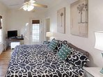Lovely bedroom with door to private deck