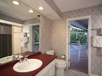 Main floor bathroom for two guest bedrooms has a shower and access to the lanai.