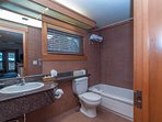 The full bathroom on the main floor is spacious and contains a shower-tub combination.