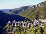Cantobre village, perched on the rocks overlooking the valleys