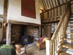 The entrance hall.  The entrance hall has comfy sofa's and chairs and a working wood burner.