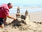 If you are feeling artistic, give sand castle sculpting a try!