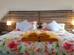Bed with feature headboard