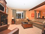 Stylish Living Room Features a Flat Screen HDTV and Gas Fireplace