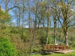 BBQ seating on the river views to woodland which is raised around to give privacy