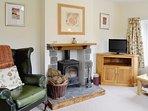 Lounge in Tulip cottage with log burner