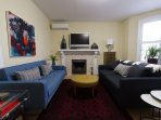 The living room also boasts a wood burning fireplace.