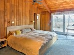 Curl up on the master bedroom's king bed for a good night's rest.