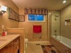 Enjoy a soothing soak in the tub.