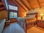 The upstairs loft-style bedroom boasts a king bed.