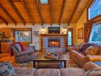 This expansive living room features a plush sectional, and 55-inch flat screen Direct TV.