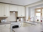 Bright, spacious and well equipped for home cooking!