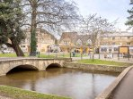 The River Windrush flows through the heart of the picturesque village