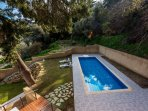 Private swimming pool 10x4 meters with sitting area and massage jets.