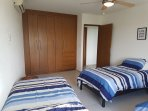 2nd bedroom with 3 twin beds