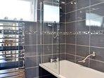 Main family bathroom with bath and overhead shower on ground floor.