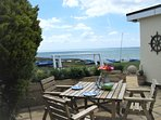 Enjoy breakfast or lunch in the garden, secluded and sheltered with fantastic sea views