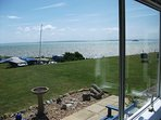 Your view from lounge across garden over The Solent to the Isle of Wight. Relax & enjoy the views