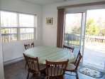 Dining room features sliding patio doors to beautiful deck