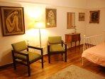 The Master Bedroom. Notice the original 1930's armchairs, and original hardwood floor
