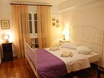 The small Bedroom has a large double bed, original antique furniture and paintings.