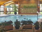The pool area, with jacuzzi, sauna, steam room, & gym (all payable locally). Outdoor pool is free.
