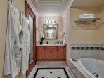 Bathroom with oval bathtub  and enclosed WC