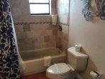Modern Bathroom W/Stone Tiling.