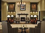Lounge in the elegant lobby with warming fireplace and comfortable sofas