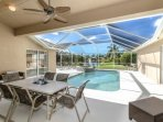 Enjoy relaxing or dining on your private poolside lanai with incredible lake views!