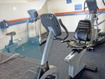 The Exercise Room is on the Ground Level next to the indoor pool