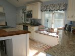 The kitchen has granite/butcher block counters & a window seat.