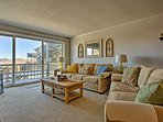 The sliding glass doors pour plenty of natural light inside as you relax.