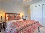 Those staying in the third bedroom will be gifted to this cozy queen bed.
