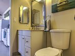 Find a mirrored vanity and walk-in shower in the bathroom.