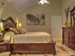 The master bedroom boasts a plush queen-sized bed.